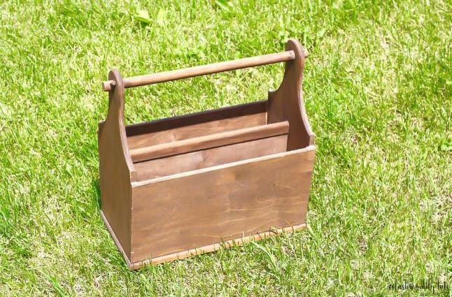 brown magazine holder sitting in green grass