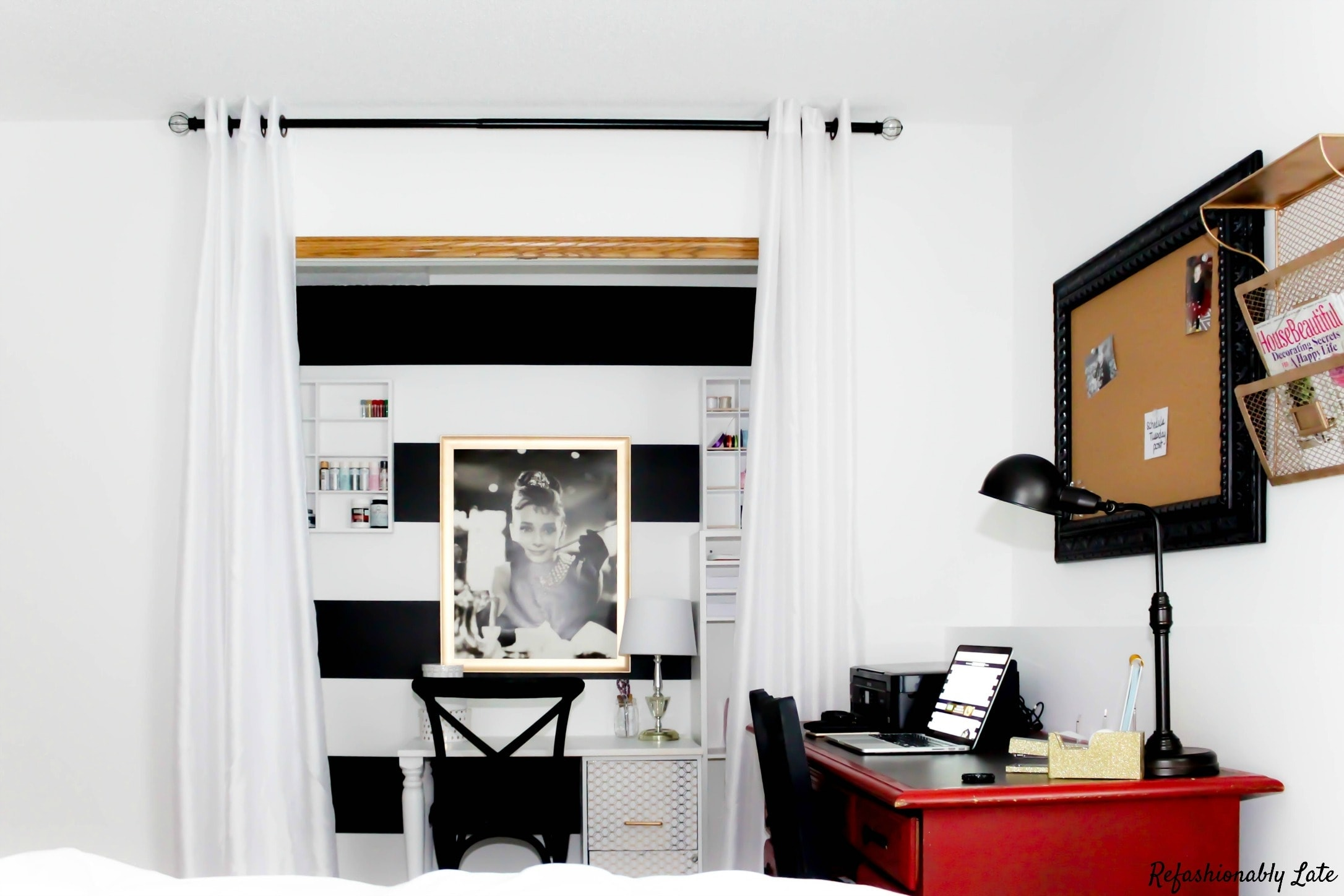 white office with a closet transformed into a craft area with white and black paint colors and a large red desk