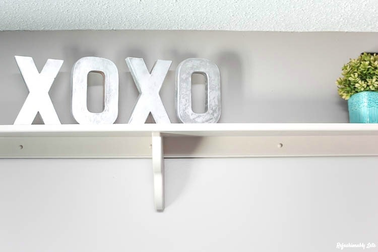 faux steel XOXO letters on top of a shelf