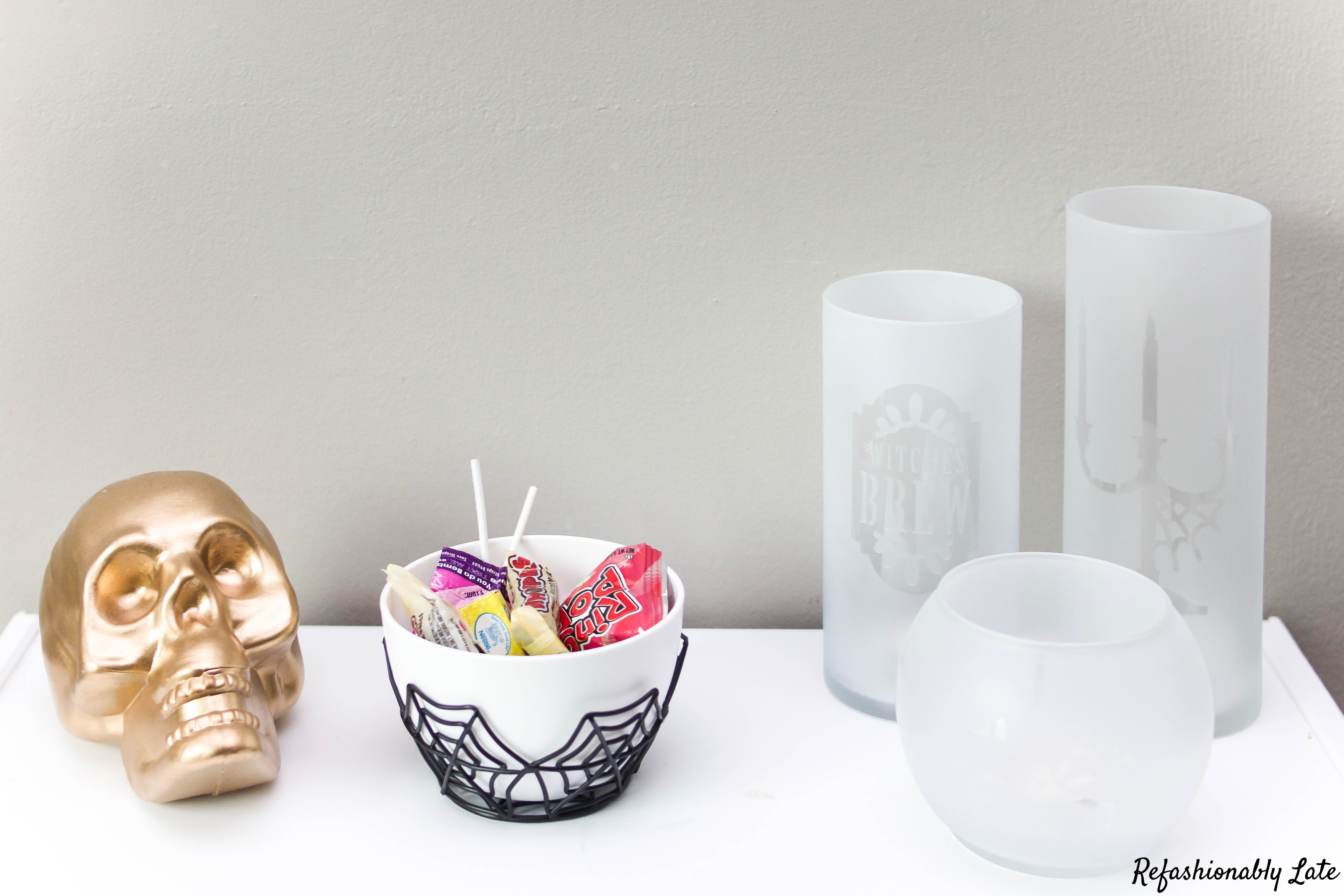 Gold skull halloween candy and 3 frosted halloween candle vases decorated with Halloween graphics