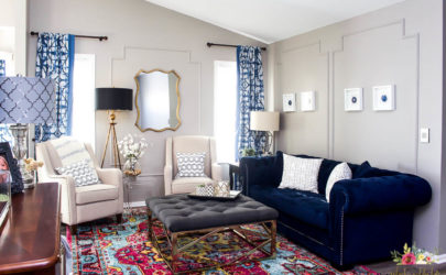 living room with walls painted requisite gray and colorful decor and furniture