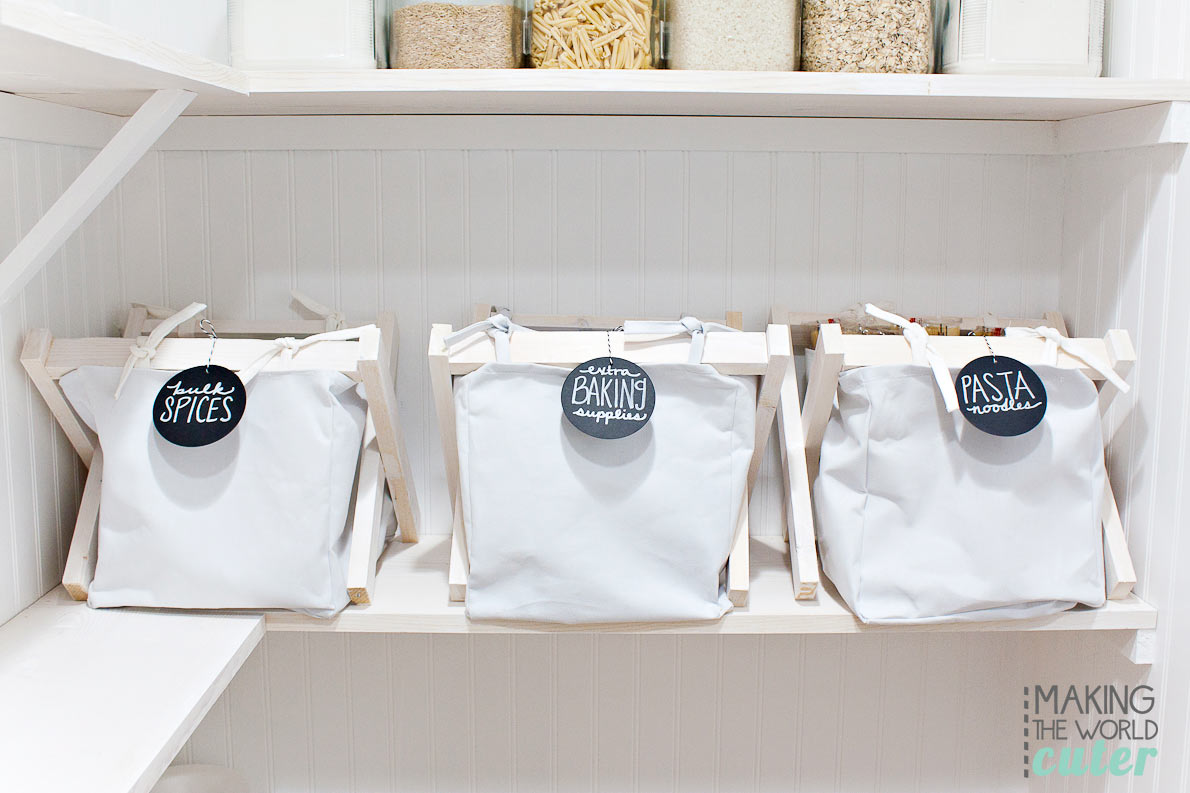 white bead board walls with white cloth baskets and black chalkboard labels