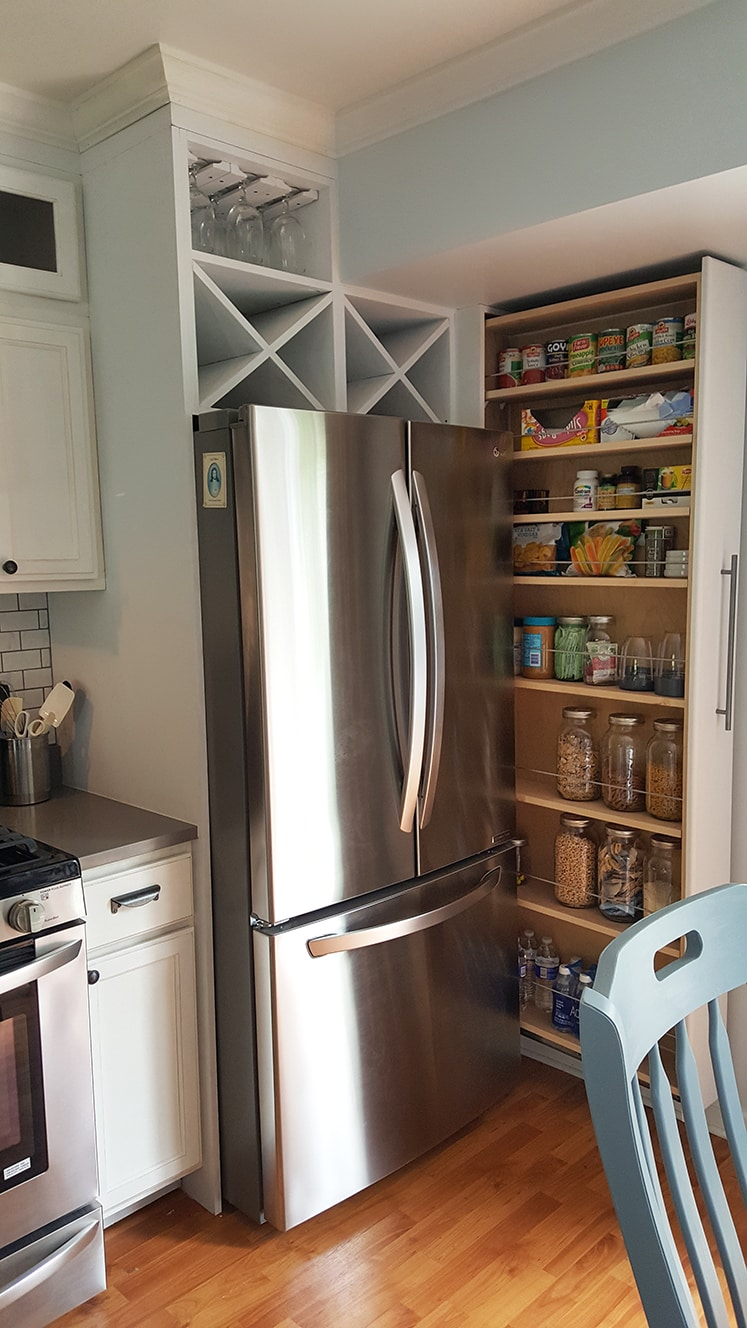 stainless steel refrigerator with a pull out organized pantry to hold various food items