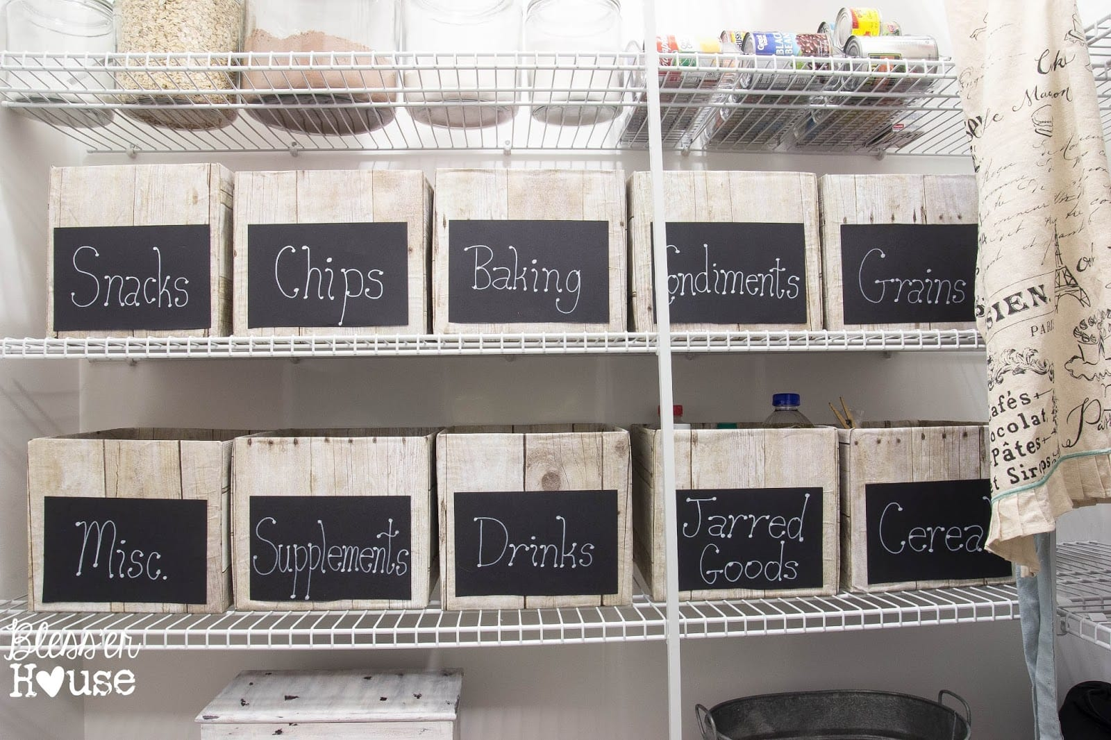 paper wrapped boxes with chalkboard labels on white wire shelving