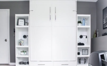 white murphy bed with two shelves on either side with decorative items against a dark gray wall and white maple allure grip strip vinyl flooring