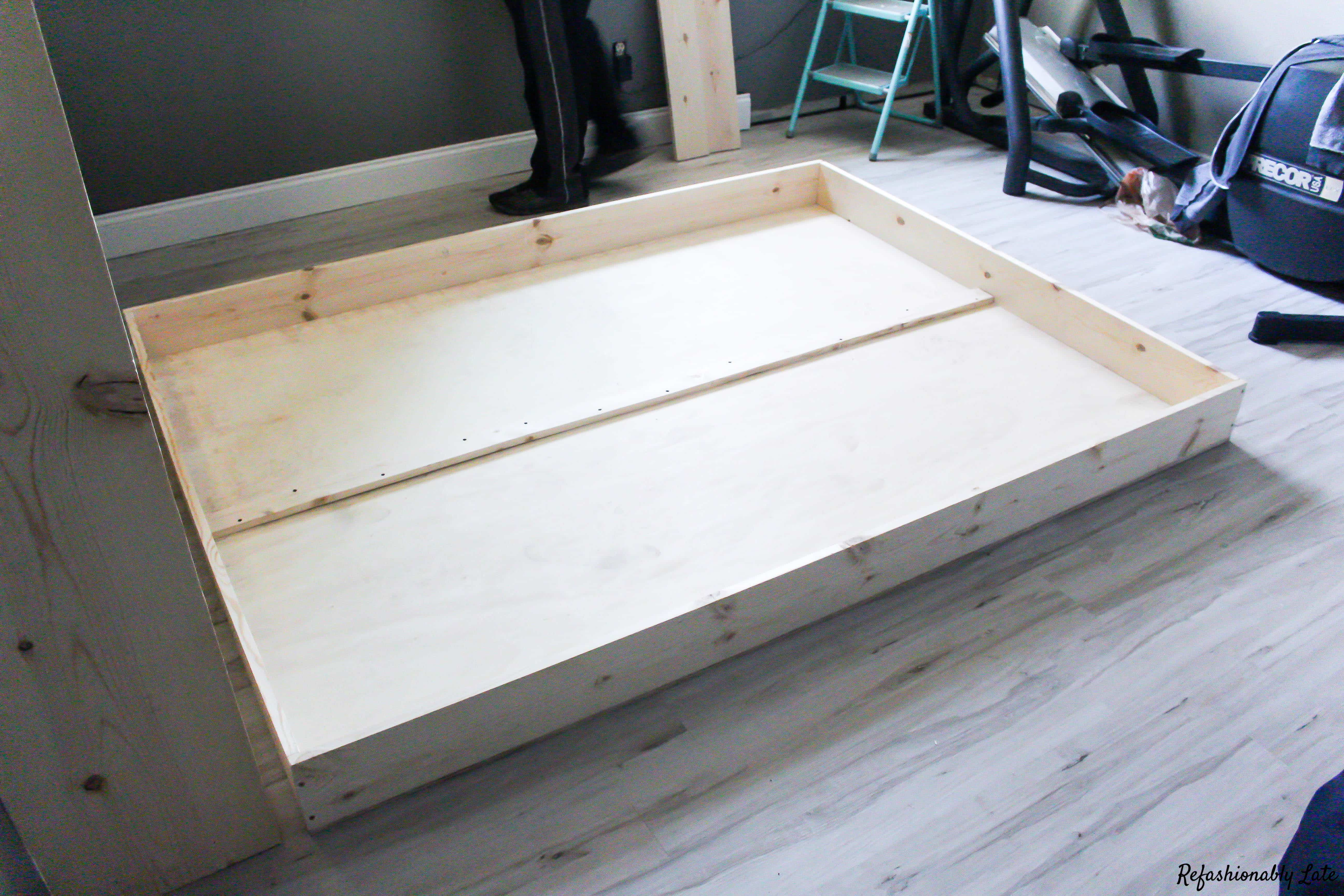 front of murphy bed frame laying on the white maple flooring