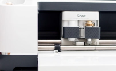 the left side view of the Cricut Maker with a close up of the Knife Blade