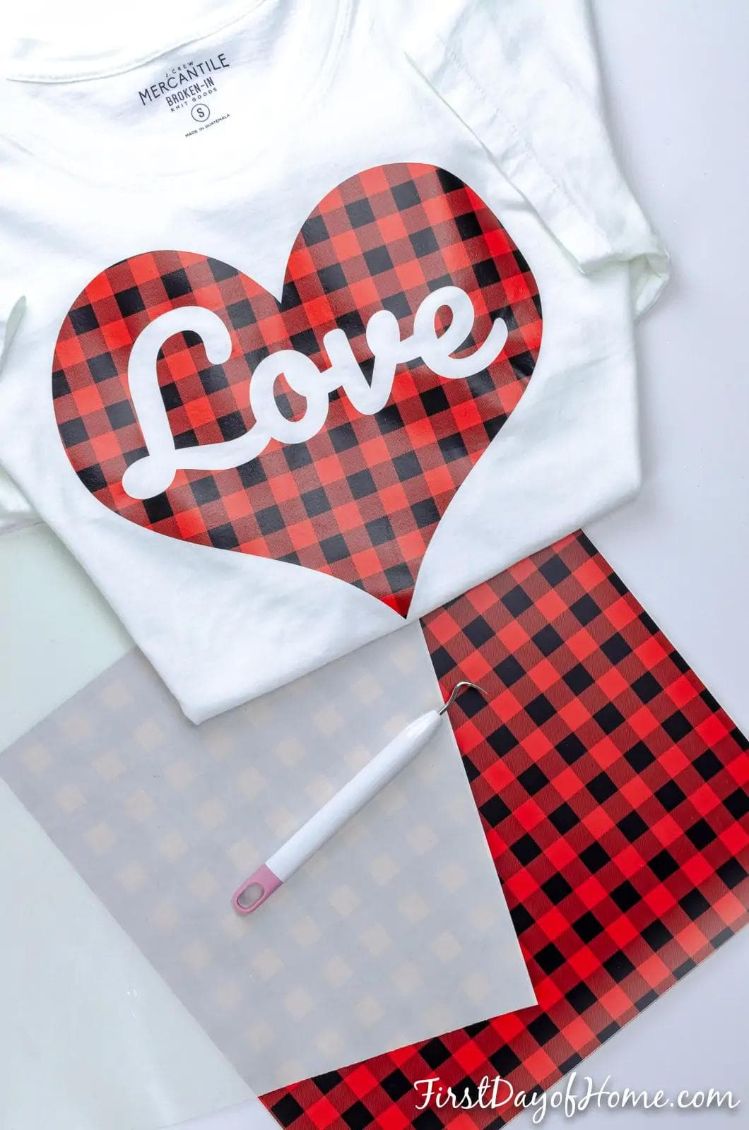 buffalo plaid heart with the word love on a white tshirt