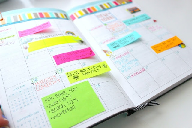 photo of a planner with post it notes and with tasks written on them