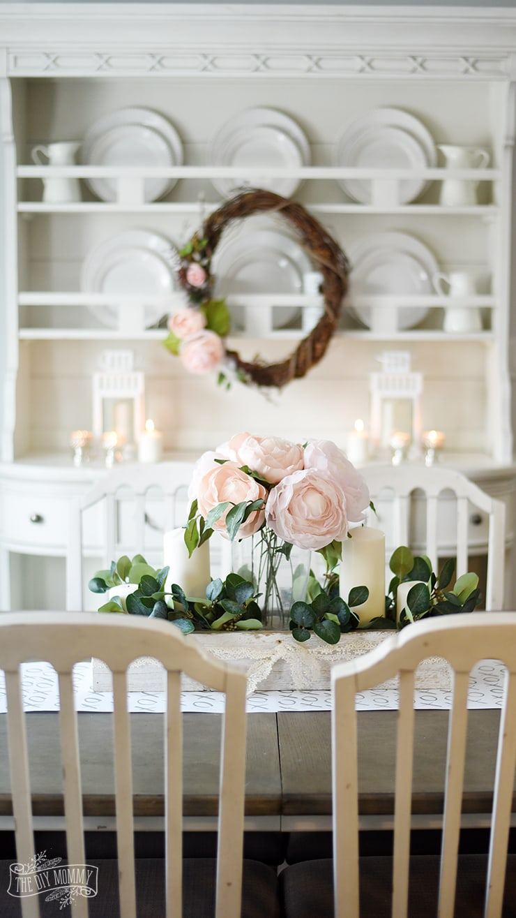 pink floral table decor with floral wreath in background