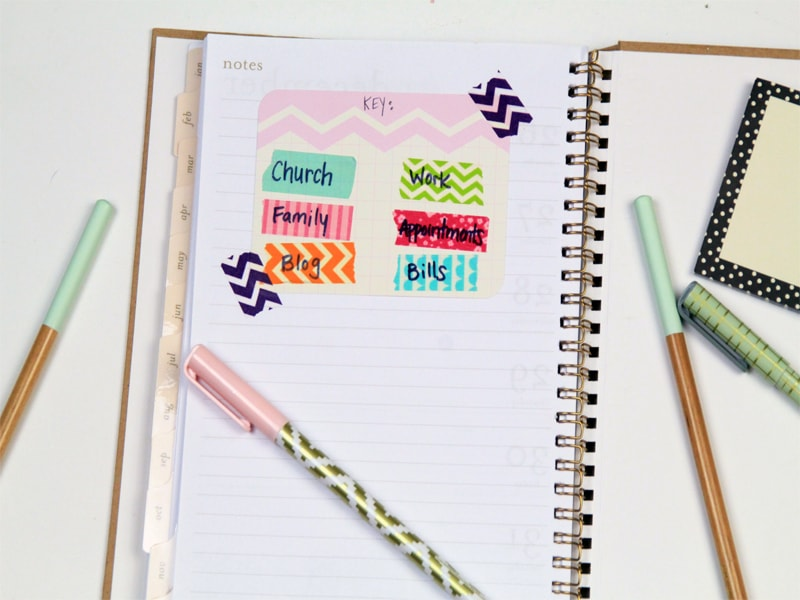planner with various washi tape and category names