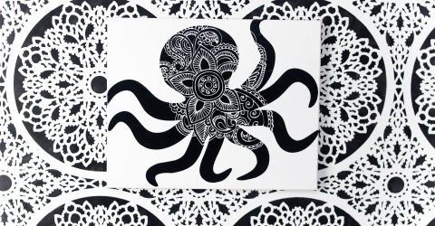 octopus wall art on a white canvas on a black and white painted wall