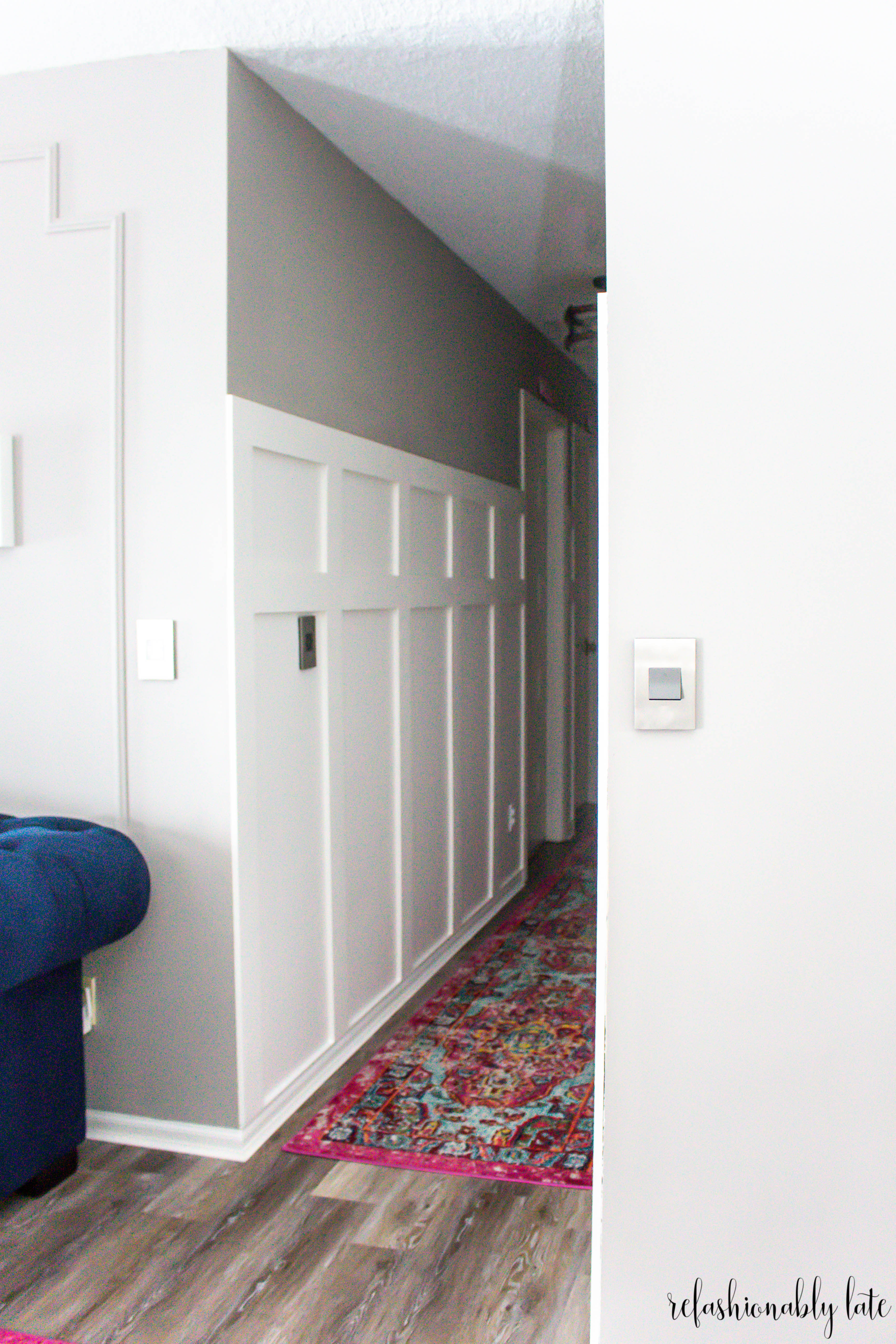 hallway board and batten with gray walls and colorful rug