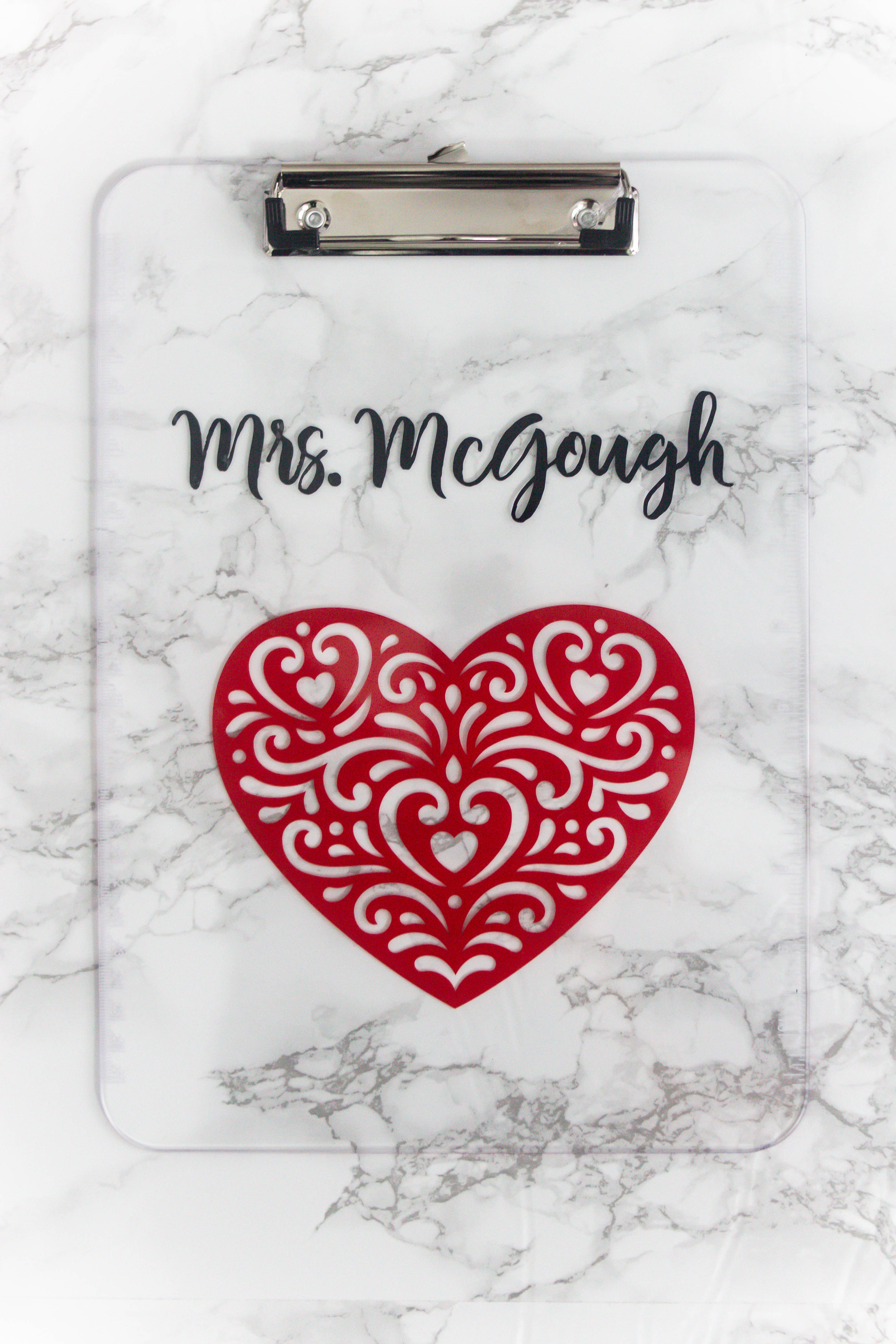marbled background with diy personalized clipboard with heart image and personalized name on top